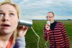 Couple talking through Tin-Can phones